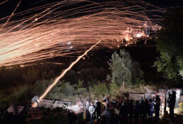 16 Amazing Photos from the Annual Easter Rocket Wars on the Island of Hios