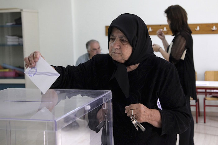 A woman wearing her traditional black-- said to be worn by the people of Anogeia in perpetuity for the burning of their village during World War II