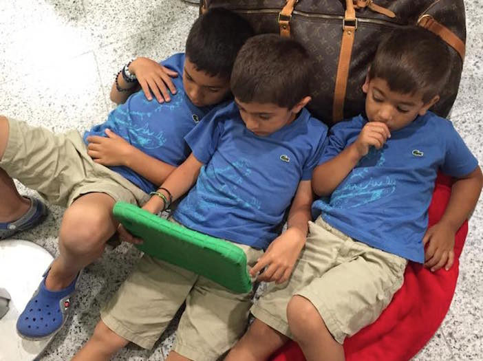 Photo by Despina Flouras-Anastasopoulos. Her three boys waiting at Athens airport for a SkyGreece representative to inform them of flight updates after Tuesday's cancellation.