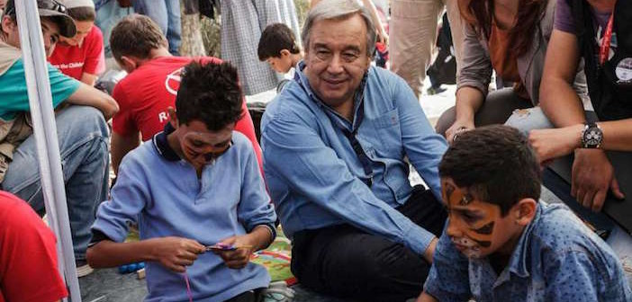 United Nations High Commission on Refugees chief António Guterres with refugee children on Lesvos