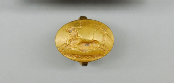 Gold ring with a Cretan bull-jumping scene was one of four solid-gold rings found in the tomb. (Photo: Department of Classics/University of Cincinnati)