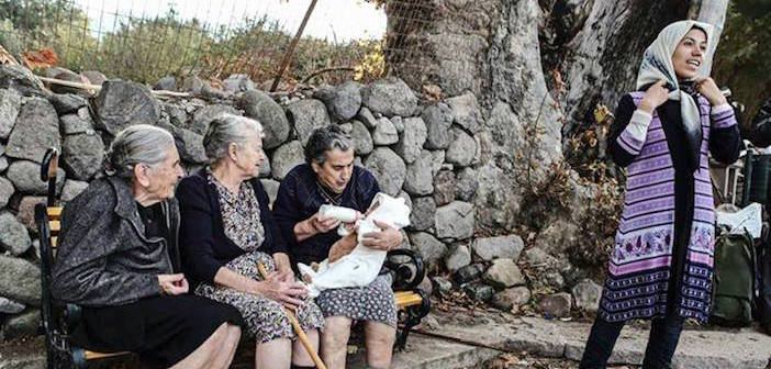 Greek grandmothers taking care of an infant while the baby's mother took a break.