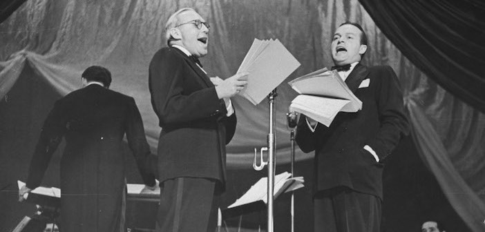 Comedians Bob Hope (L) and Jack Benny (R) performing at a Greek Relief charity show.