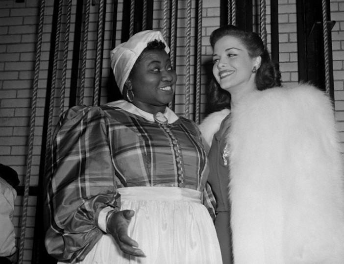 """3/28/1941- New York: Stars at Greek war relief benefit. Hattie McDaniel, who won an Academy Award for her role in the movie """"Gone With The Wind,"""" and Carol Bruce, musical comedy star, were among those celebrities who appeared at the Greek War Relief at the Radio City Music Hall."""