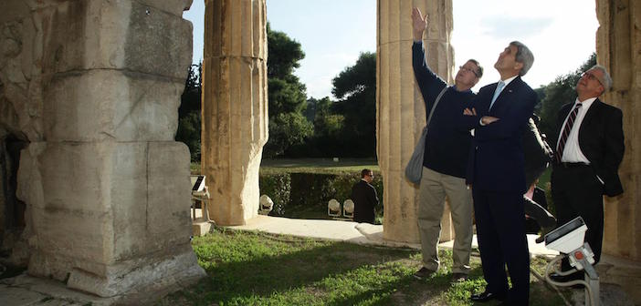 Secretary of State John Kerry hears about the origins of Athenian Democracy from Dr. Kevin Daly of the American School of Classical Studies at Athens at the Temple of Hephaestus