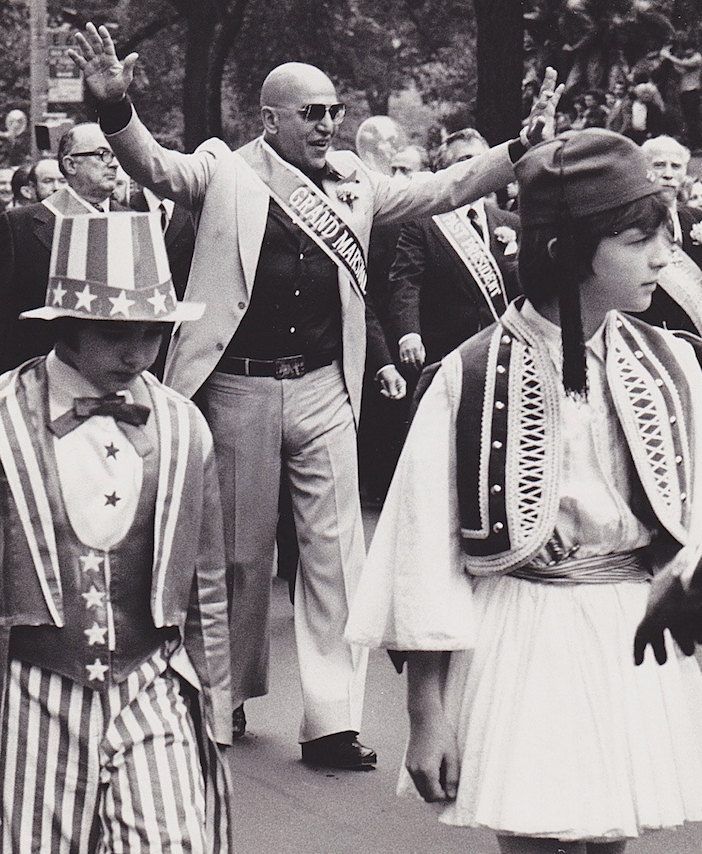 Telly Savalas marches in New York City's Greek Independence Day Parade as the Grand Marshall on May 16, 1976