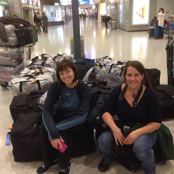 A volunteer mission under way with Carry the Future volunteers arriving in Athens with dozens of checked bags containing hundreds of baby carriers