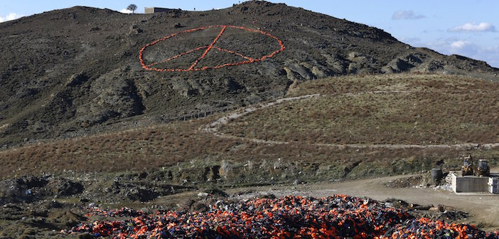 Discarded lifejackets, used by refugees and migrants, are seen on a dumpsite as volunteers from various NGOs arrange more than 2,500 discarded lifejackets in the shape of the peace symbol, on the Greek island of Lesbos