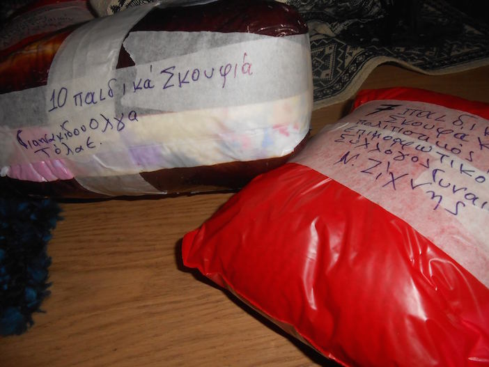 Parcels of knitted hats, gloves and scarves are arriving from throughout Greece and the world daily