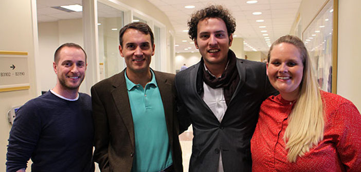 Nikos Kavounis, second from right, is bringing his Greek sparkling wine to the U.S. with help from VCU MBA students Jonathan Stoffer, left, Matt Guise and Kristina Friar. Photo by Jonathan Spiers, Richmond Bizsense