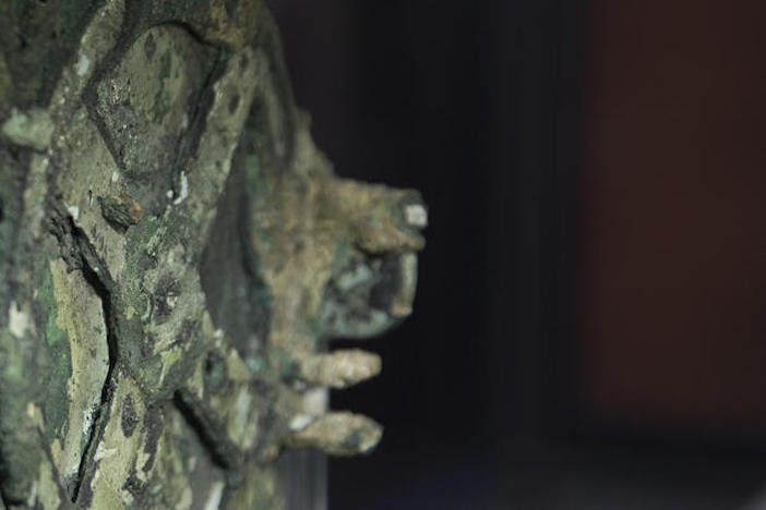A Fragment of the 2,100-year-old Antikythera Mechanism, believed to be the earliest surviving mechanical computing device, is displayed at the National Archaeological Museum, in Athens