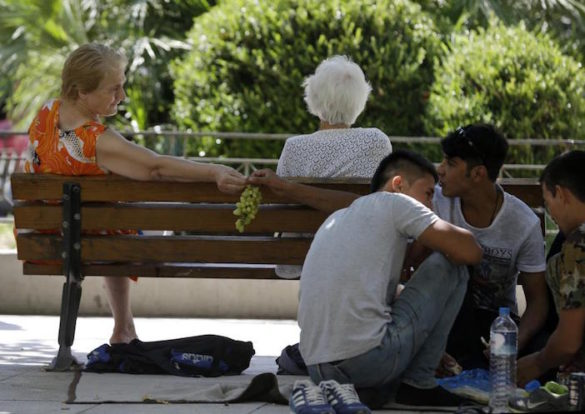 France to Relieve Some of Greece's Refugee Burden; Promises to Take 30,000 Refugees Stranded in Greece