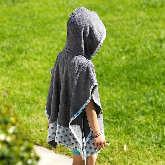 The kids' poncho is a perfect protection from the hot, Australian sun.